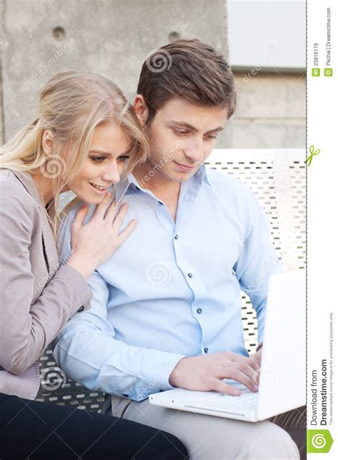professional couple happy young professional couple using laptop royalty free