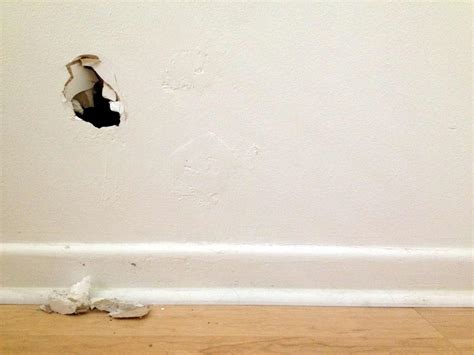 fix hole in wall drywall repairs fix it