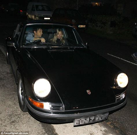 kate moss arrives at her cotswolds home in vintage porsche
