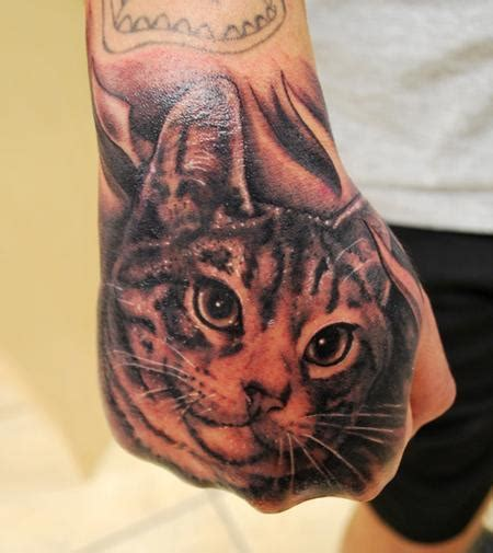 cat tattoo in hand muecke cat hand tattoo by george muecke tattoonow
