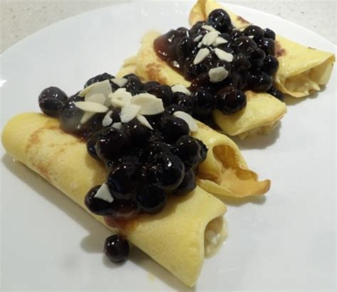 almond and cottage cheese filled crepes with blueberry and