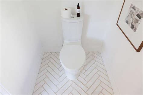 White Bathroom Floor Tiles by White Herringbone Bathroom Tiles Design Ideas