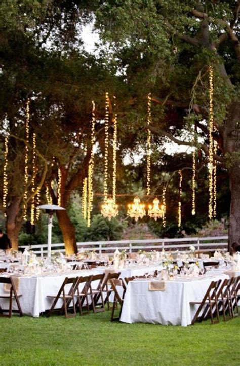 vertical tree lights how to hang lights vertically from trees weddingbee
