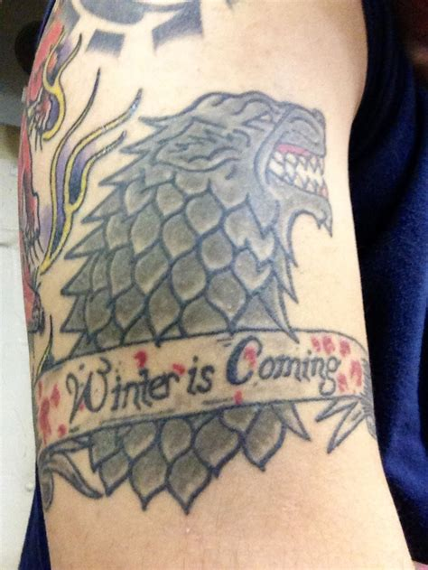 dire wolf tattoo of thrones house stark winter is coming