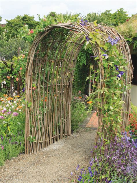 Arches Garden Of Living Willow Arch With Purple Clematis Hgtv