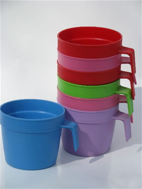 Bright colors vintage plastic picnic cups, stackable mugs w/ hook handles