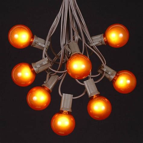 orange g40 globe round outdoor string light set on brown