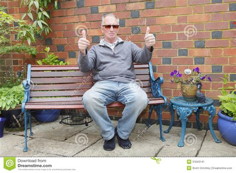 guy sitting on bench man sitting on a bench stock image image 31643141