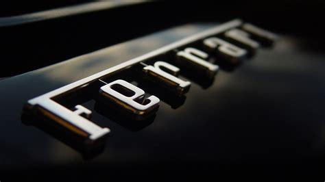 A Ferrari Sports Car Is An Exle Of An Unsought Good by Ferrari Logo Hd Wallpaper