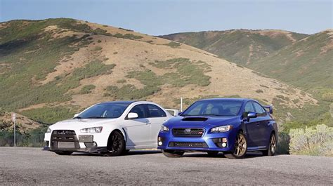 subaru evo 10 the big debate subaru wrx sti or mitsubishi lancer