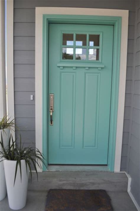 i want a turquoise front door so bad and this is the pin since i figured a gray house