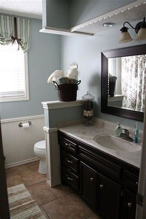 blue gray walls and espresso cabinets bath ideas juxtapost