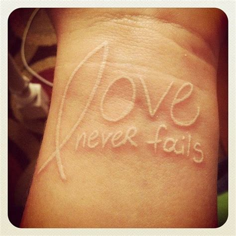 love never fails tattoo never fails with jesus fish tattoos