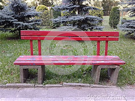 red park bench red bench stock photo image 42640832
