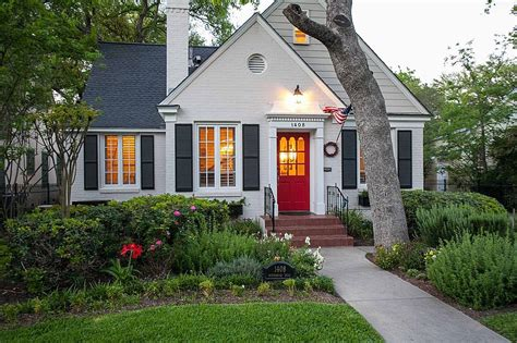 classic cottage painted white brick gives this classic cottage a fresh