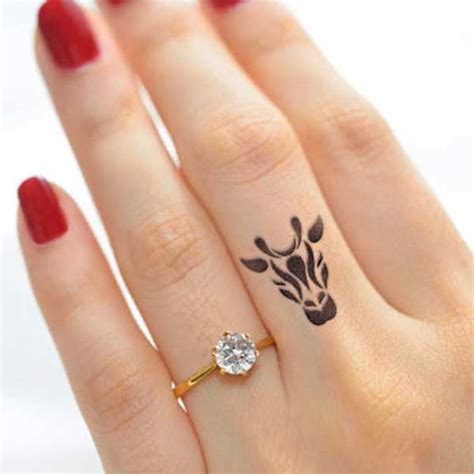 small tattoo on finger cost best 20 african tattoo ideas on pinterest