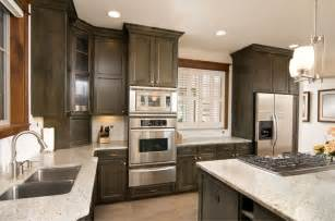 Kitchen design with a stainless steel wall oven and microwave on top