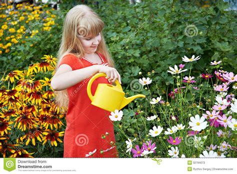 girl watering flowers little girl watering flowers stock photos image 32794073