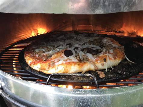 Oven Webber pizza on the charcoal grill