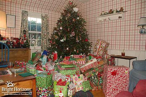 images of christmas gifts under the tree siblings and holiday gifts tips for fair gift giving