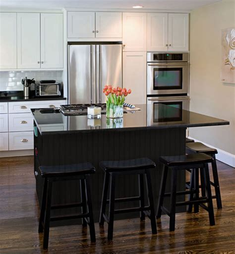 white kitchen cabinets with black island black kitchen furniture and edgy details to inspire you