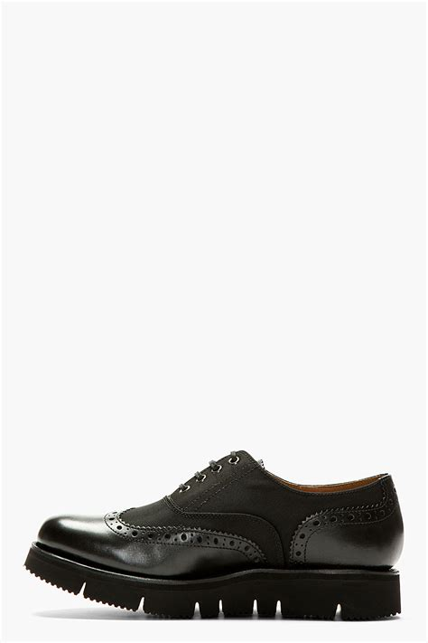 foot the coacher black canvas and leather max austerity