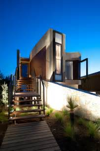 The contemporary decks and landscaping echo the modern edge of the