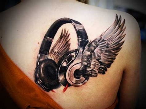 quot earphones with wings quot back tattoo tattoos pm