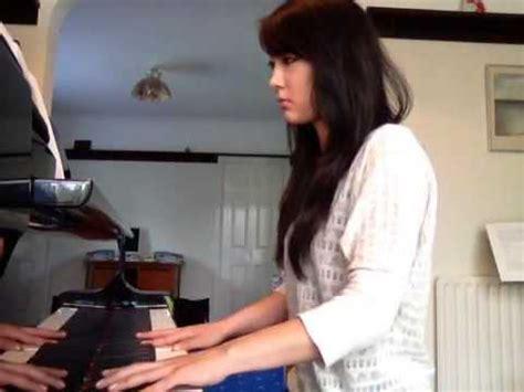 blindfolded chou qi li xiang orange on piano chou lara coral sea doovi