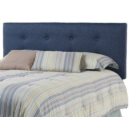 button tuck headboard with symmetrical button accents and straight lines the