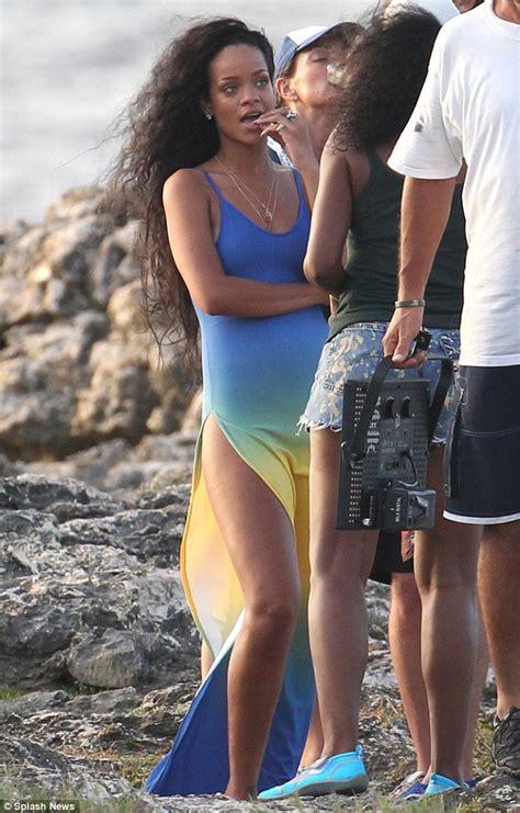 Rihanna slips on a white bikini and daisy dukes to go bareback horse