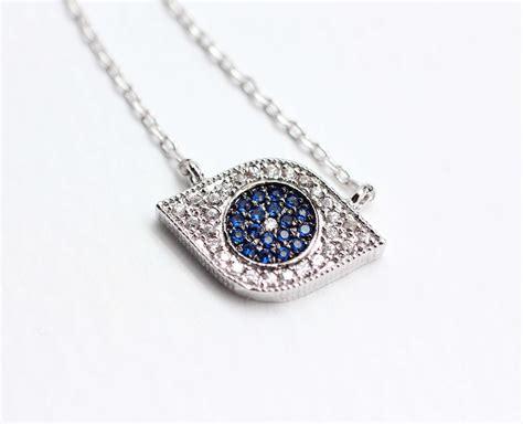 evil eye pendant necklace detailed in swarovski blue