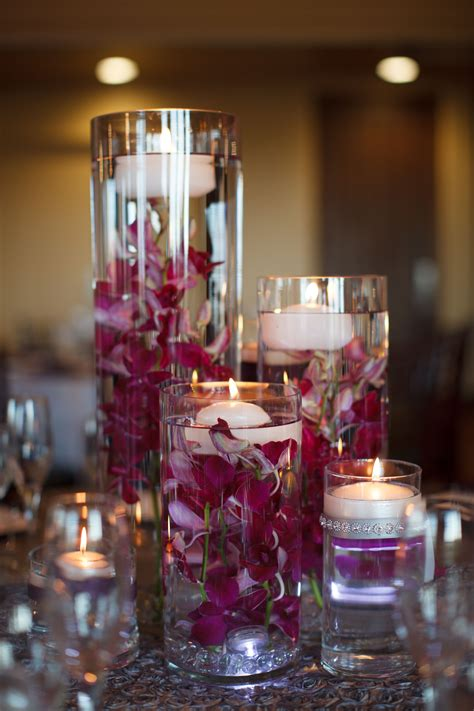purple orchid  floating candle centerpieces