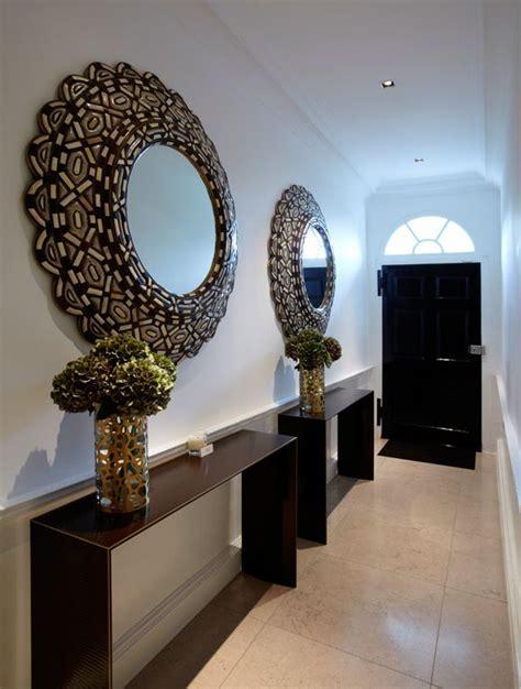 dramatic pair  mirrors   long narrow entrance hall