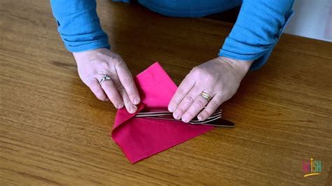 Folding Silverware Into Paper Napkins - how to make a napkin roll up