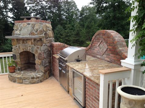 Brick Outdoor Kitchen Pics - outdoor kitchen designer blends bricks with to mesh