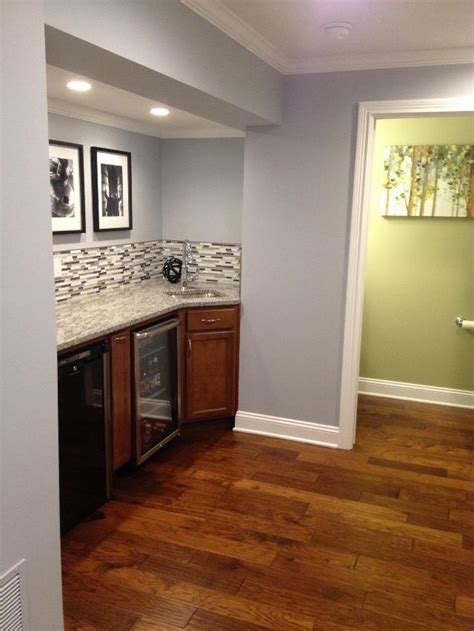 gray paint with cherry cabinets sherwin williams krypton with artificial light basement