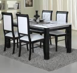 dining room with black and white chair covers naya