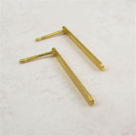 gold bar stud earrings by misskukie notonthehighstreet