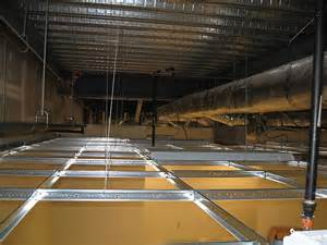 dropped ceiling grid passing an above grid ceiling inspection the junction box