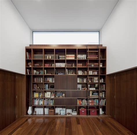 minimalist bookshelves modern architecture marked in minimalist boxy shapes aradas house home building furniture