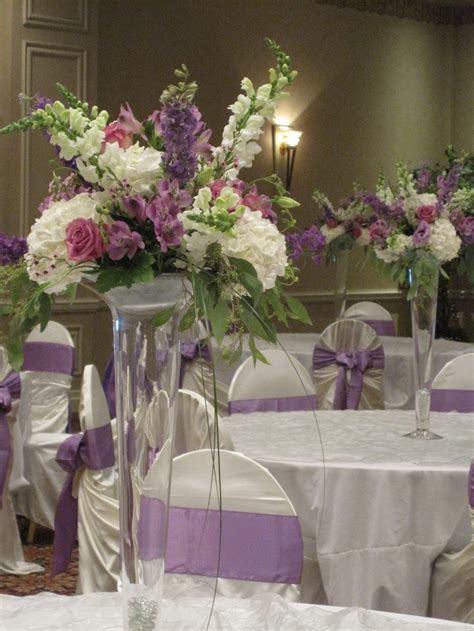 trumpet vase centerpieces in lavender and white with