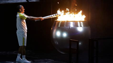 Lighting Olympic Torch by Reliving 16 Great Moments From The Olympics