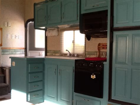 trailer kitchen cabinets rv remodel after picture from the same ole oak cabinets
