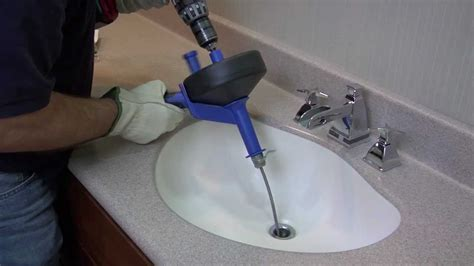 how to snake bathroom sink how to unclog a drain using a cobra drum auger youtube