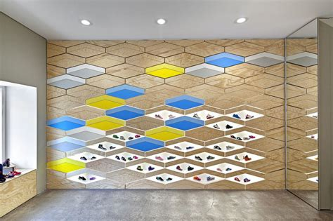 Modern Living Room Idea interactive wall design at suppakids sneaker boutique in