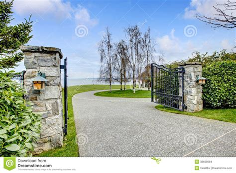 Walk Out Ranch House Plans entrance iron gates with stone columns stock images