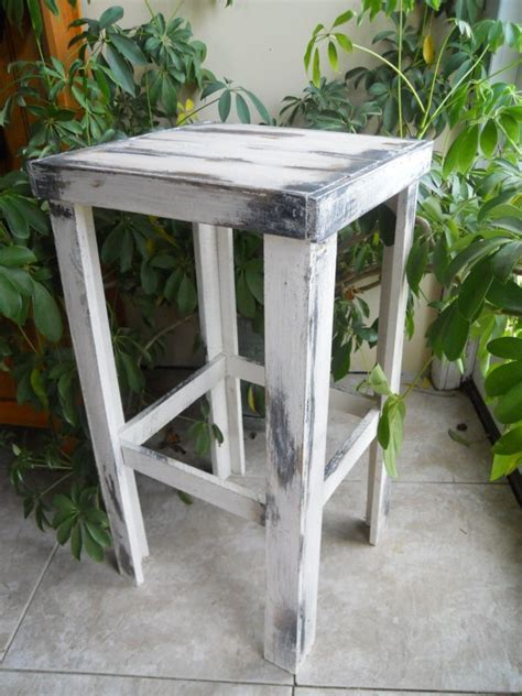 serene village rustic distressed wooden table plant