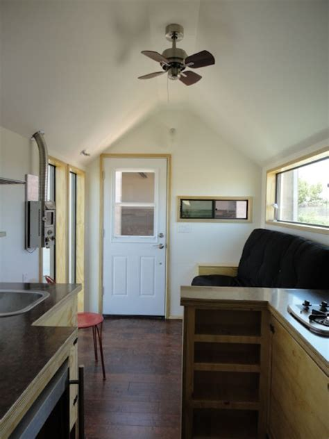 interiors of home meet this living in a 204 square foot tiny house