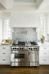 backsplash counters vent hood range ceiling kitchen